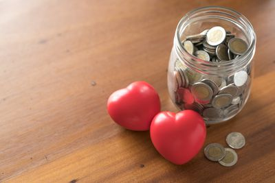 Jar with change and 2 red hearts.