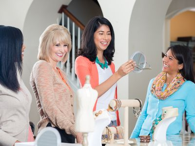 A Group of Young Women Looking at Products