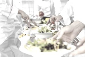 Chefs are preparing salads at catered event