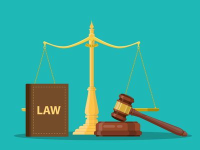 Wooden gavel, scales of justice and law book