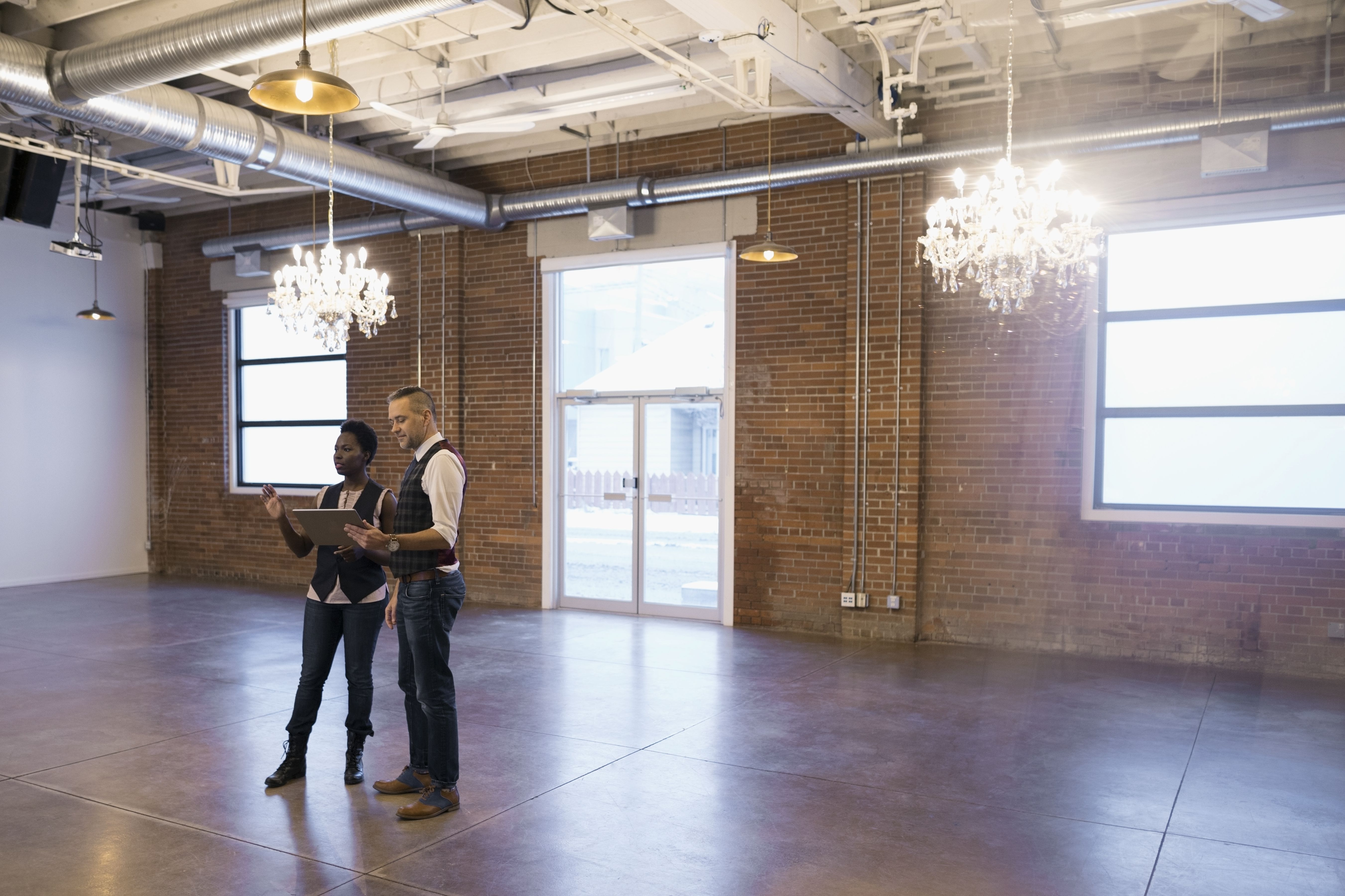 Event planners surveying an event space
