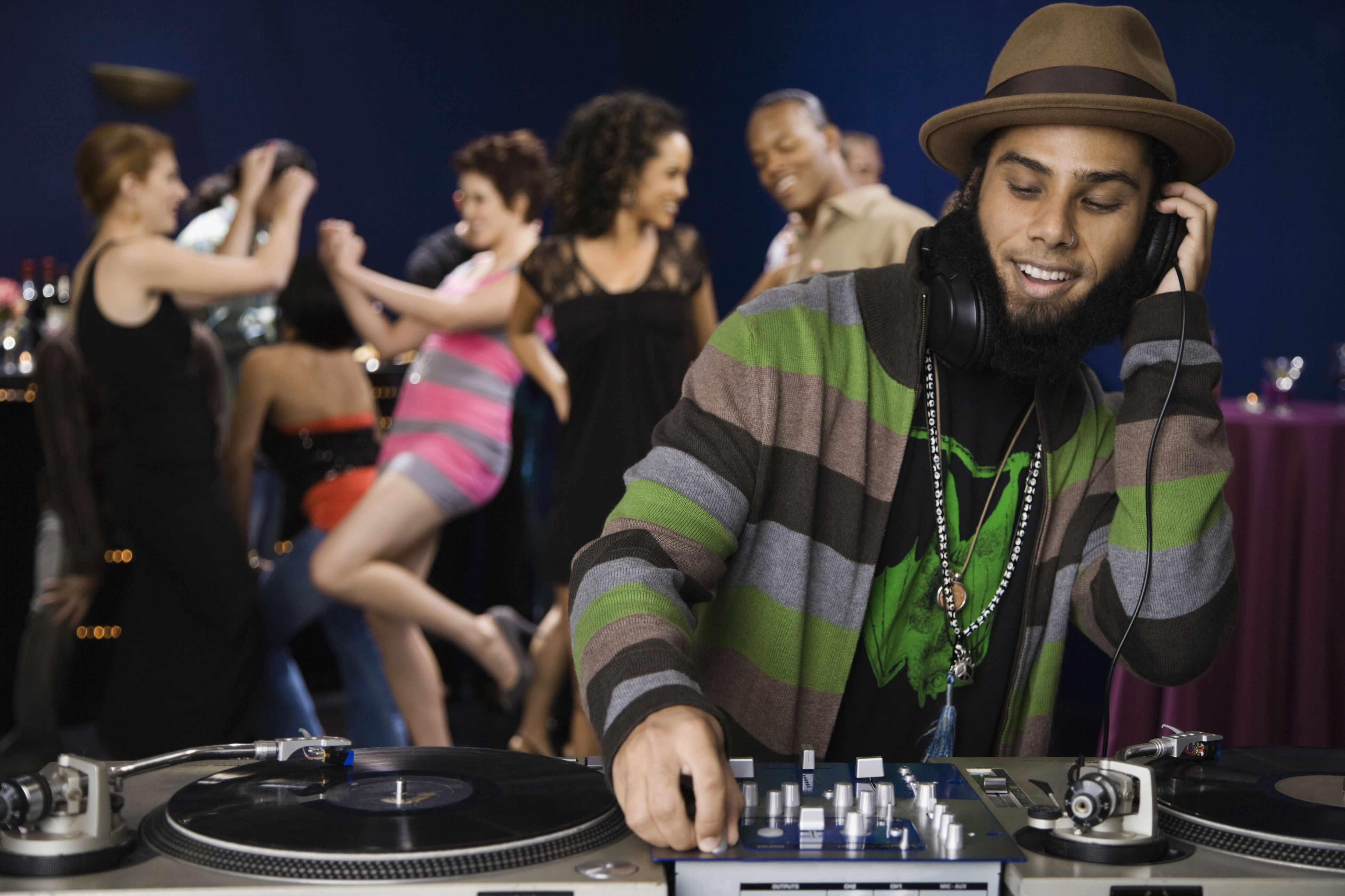 DJ spinning records at a dance party
