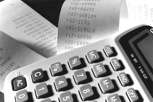 Close up of accountancy adding machine with rolls of data.
