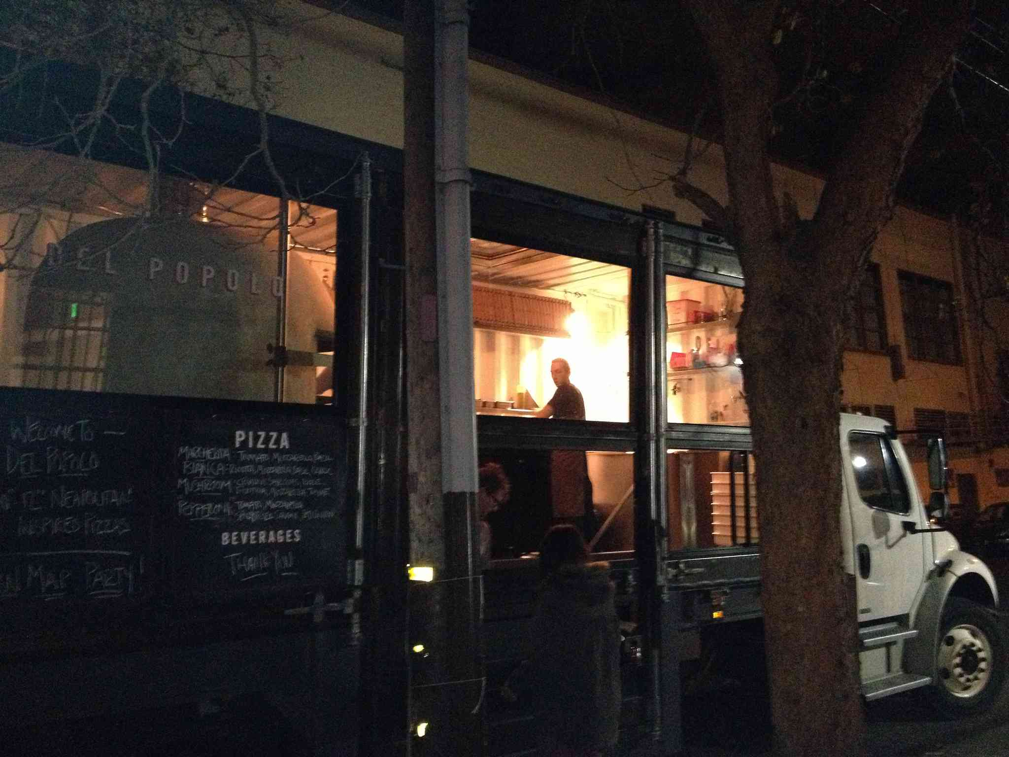 Del Popolo's wood-fired pizza truck catering a party