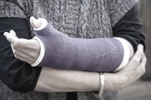 Midsection of woman wearing a broken arm cast