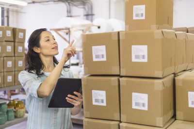 Woman calculating safety stock in a warehouse