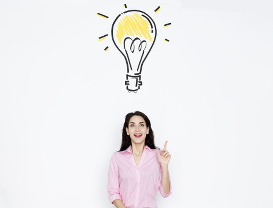 Woman with light bulb over her head, representing a creative idea.