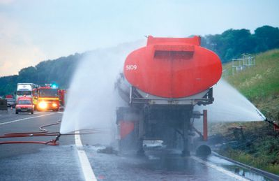 Cooling tanker carrying dangerous chemicals after is has caught fire on the M5 motorway