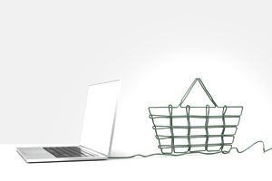 Laptop computer with green ethernet cable forming a shopping basket