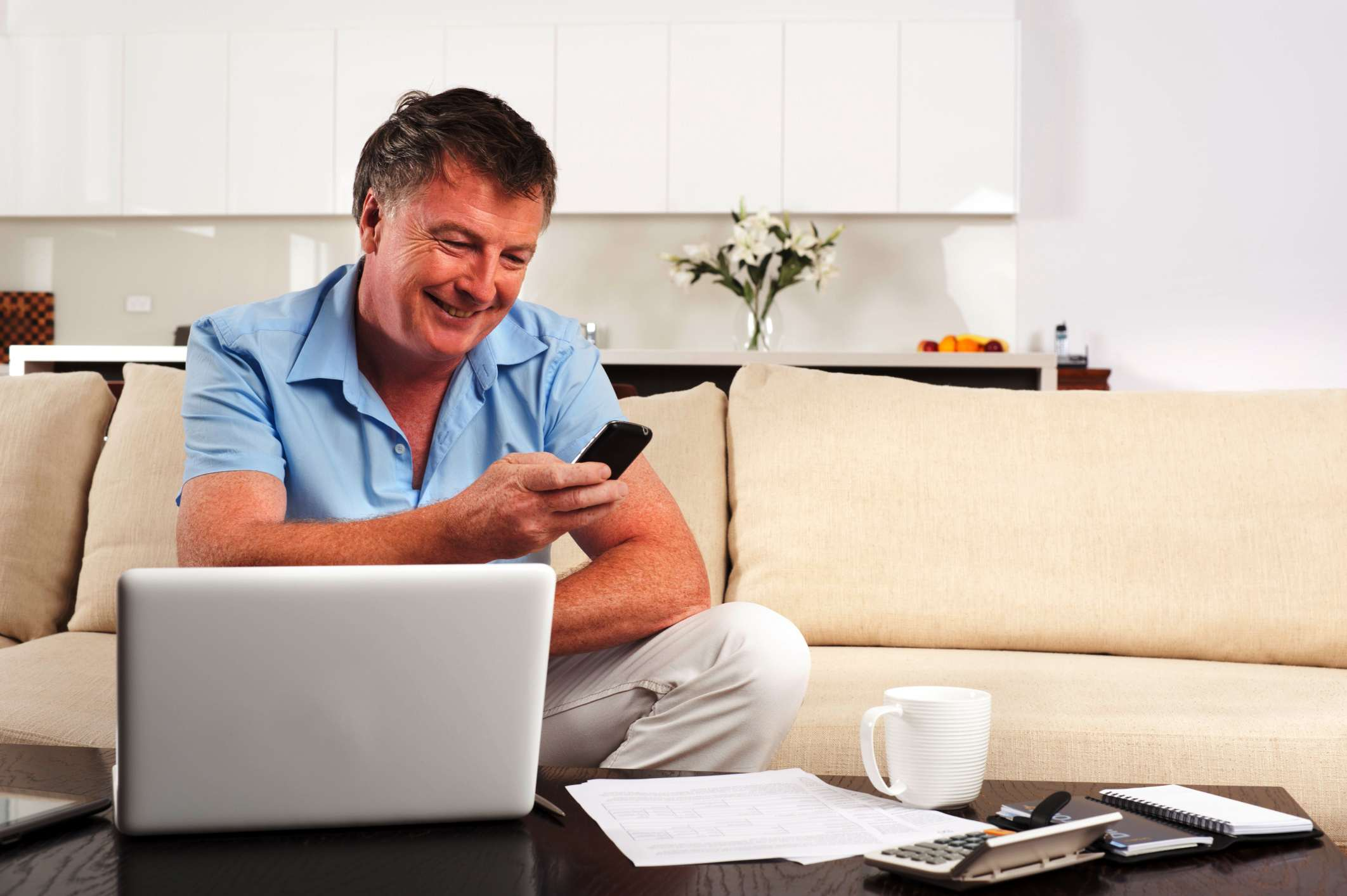 Man working on income tax at his laptop