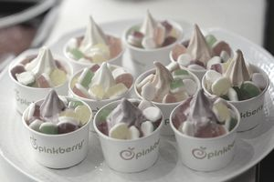 Pinkberry cups of frozen yogurt on a tray