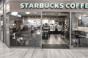 Exterior view of a Starbucks Coffee franchise in a mall.