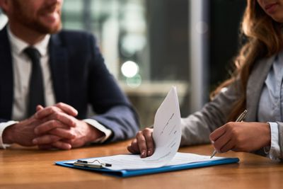 businessman and businesswoman completing paperwork together