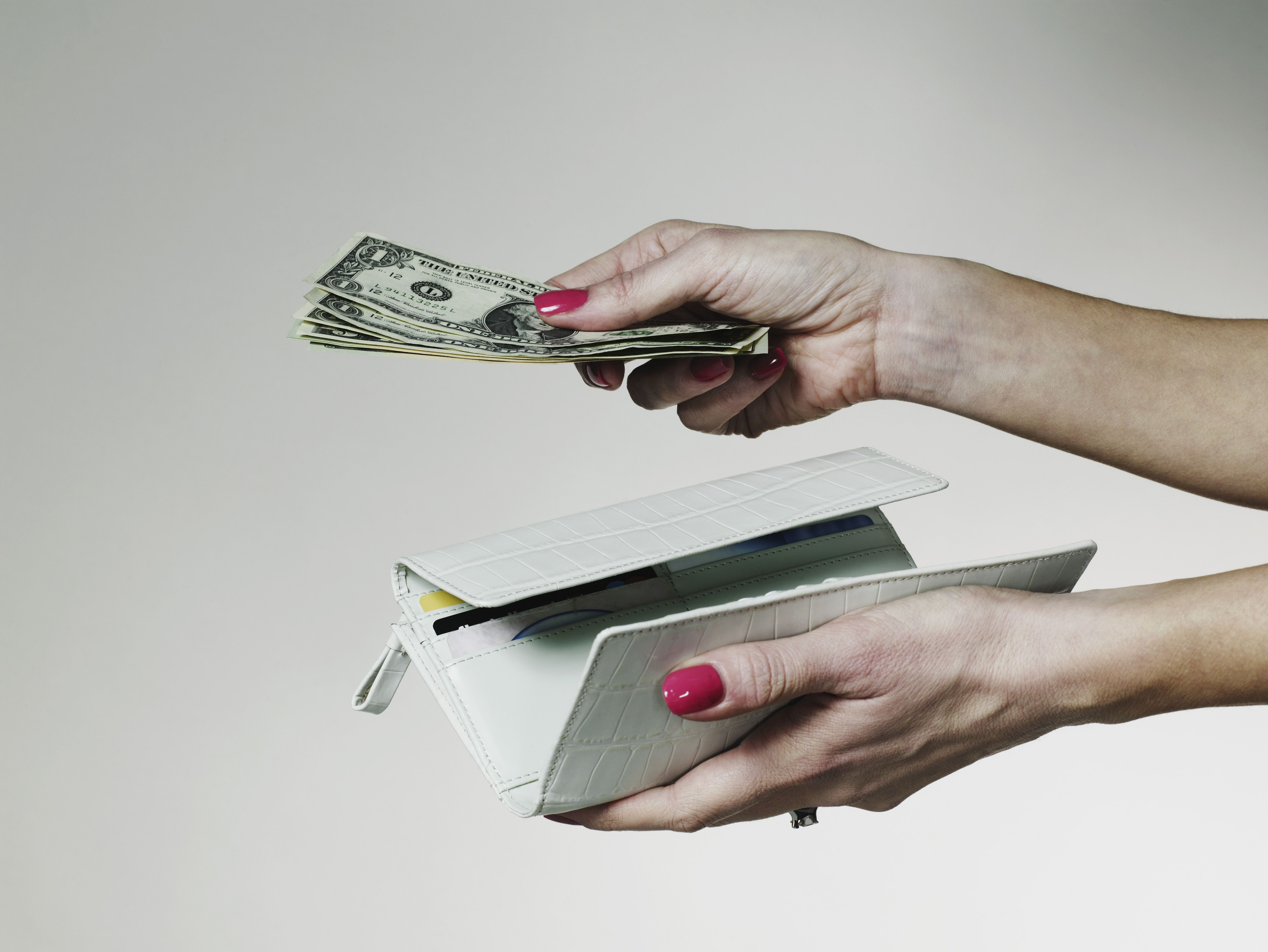 Hands with billfold and cash