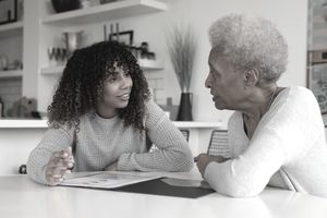 Female financial advisor talking to client.