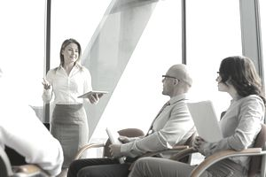 Advertising Manager standing in the front of a meeting