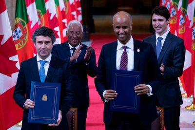 Canadian and Portuguese ministers sign part pf the CETA agreement on Parliament Hill in Ottawa, Ontario, May 3, 2018