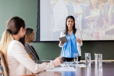 Businesswoman discussing charity event at meeting