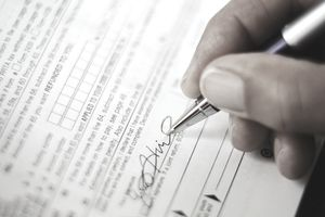 Business signing corporate tax form
