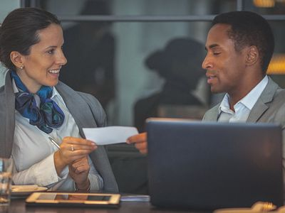 Young businesswoman and man working together on a laptop