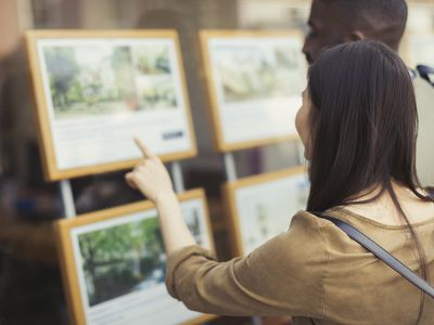 couple browsing property rental offerings