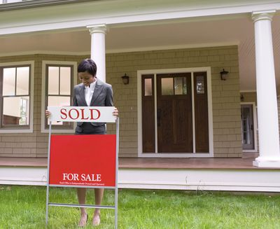 Real estate agent putting