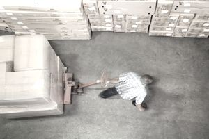 Man pulling pallet with stack of boxes