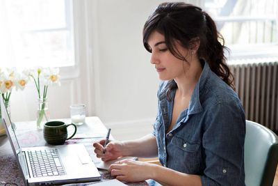 a young woman working on a laptop