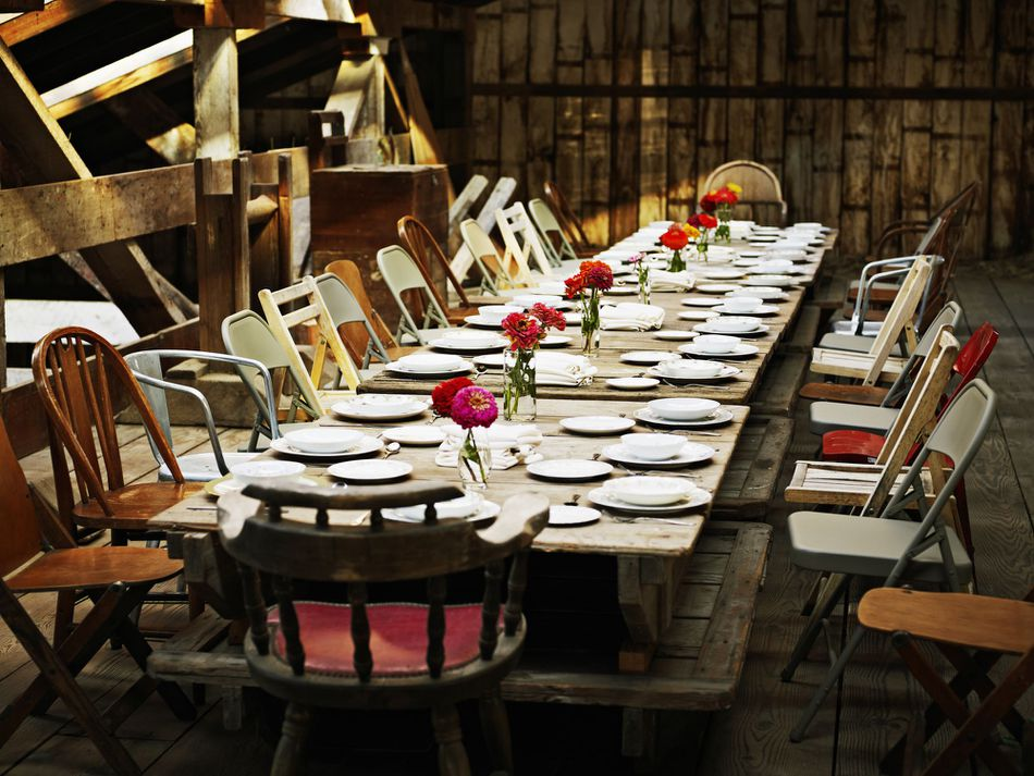 Table set for dinner inside rustic building
