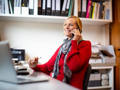 An SMB owner finishes up a call with her accountant.
