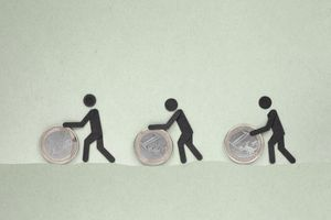 Illustration of people rolling coins toward a common goal representing crowdfunding.