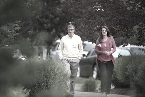 Bill and Melinda Gates walking down the street