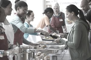 Workers for a non-profit organization providing community meals.