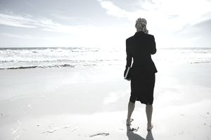 Business woman standing on a beach representing Blue Ocean Strategy.