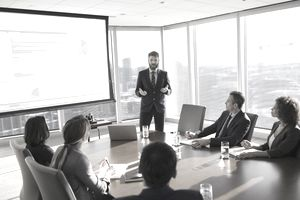 Businessman leading presentation at a stock corporation