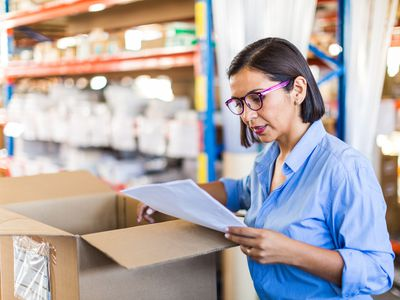 A warehouse manager checks inventory levels