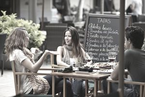 Woman explaining to friends at restaurant
