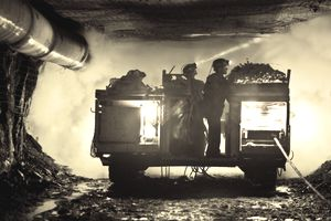 Two coal miners in mine shaft