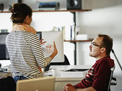 Coworkers discussing project in startup office
