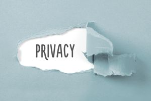 Close-Up Of Text Privacy On Blue Wall - stock photo