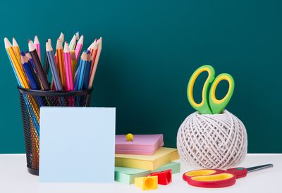 Close-Up Of Colorful School Supplies On Table