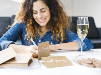 Woman writing thank you letter