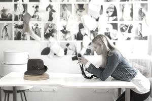 Woman taking picture of hat