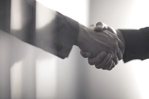Handshake in contemporary office space