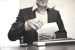 man opening an envelope