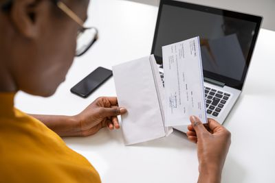 Woman looking at her paycheck