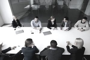 an overhead view of a group of business people having a business meeting