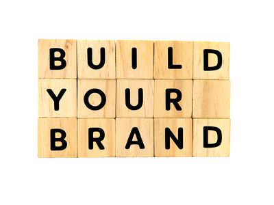 Build Your Brand Text on Wooden Blocks on White Background