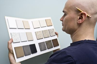 Man selecting stone for countertop