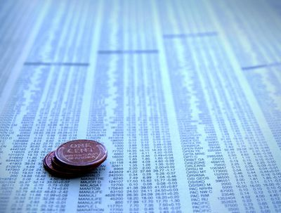 Stack of coins on stock exchange list